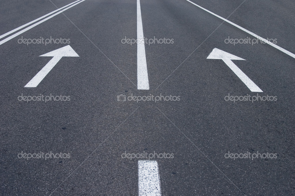 Photo of road signs arrows on asphalted surface  — Stock Photo #3973534