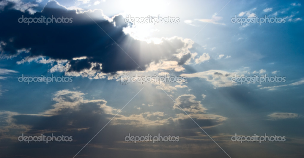 Sun beams over heavy dark clouds  Foto Stock #3973864