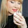Young woman drinking milk — Stock Photo #3992456