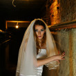 Stock Photo: Frightened bride in dungeon
