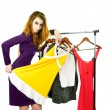 Young woman tries on dresses - Stock Photo