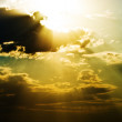 Sun beams over heavy clouds — Foto Stock