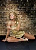 Beautiful woman in golden dress — Stock Photo
