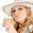 Cowgirl with whiskey - Stock Photo