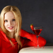 Smiling woman with juice cocktail — Stock Photo