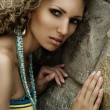 Fashion portrait against stone wall - Foto de Stock