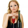 Beautiful blond woman with wine — Stock Photo