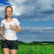 Running young woman — Stock Photo