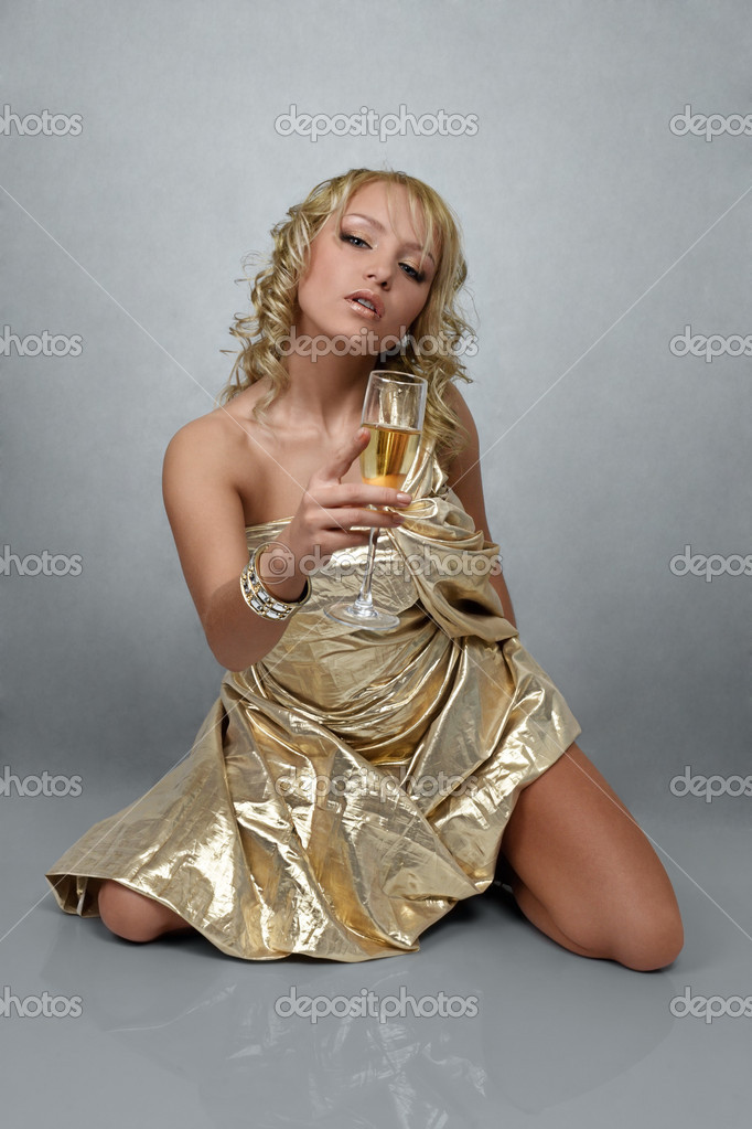 Young blonde beautiful woman with champagne glass — Stock Photo #5179886