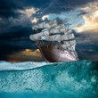 Sail ship in storm sea - Stock Photo