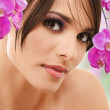 Woman face with orchid flowers — Stockfoto