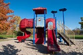 Park with Playground Equipment in Autumn — Stock Photo