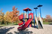 Park med lekredskap i höst — Stockfoto