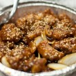 Stock Photo: Takeout Chinese Sesame Chicken