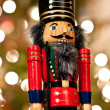 Nutcracker in Front of a Christmas Tree — Stock Photo #4224010