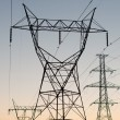 Stock Photo: Electrical Transmission Towers (Electricity Pylons) at Sunset