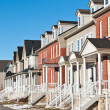 Row of Recently Built Townhouses on a Suburban Street - Stock Photo