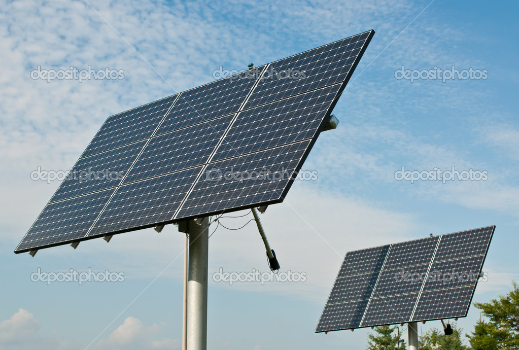 Photovoltaic solar panel arrays with blue sky and white clouds in the background. — Photo #4530193