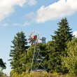 Stock Photo: Windmill with Trees and Blue Sky