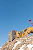 Hydraulisk grävmaskin på vintern — Stockfoto