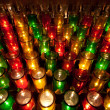 Stock Photo: Colorful Votive Candles in Church