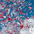 Red and White Confetti in the Air - Foto Stock