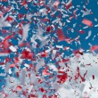 Red and White Confetti in the Air - Stok fotoraf
