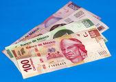 Mexican Peso Bills Over Blue — Stock Photo