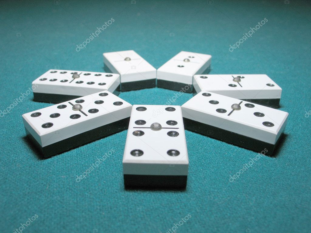 Double Dominoes ordered like a flower on a lighted table.   Stock Photo #4180294