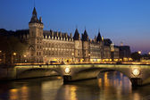 Castle Conciergerie And Bridge Of Change — Stock Photo