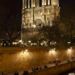 Embankment of Seine River and Notre Dame de Paris at night — Stock Photo #4189237