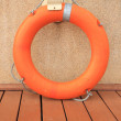 Stock Photo: Life preserver on pire