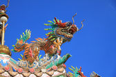 Chinese ancient lion statue on the roof — 图库照片