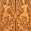 Stock Photo: Close golden carve door of church
