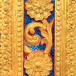 Stock Photo: Golden Thai carve on temple door