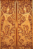 Close golden carve door of church — Stock Photo