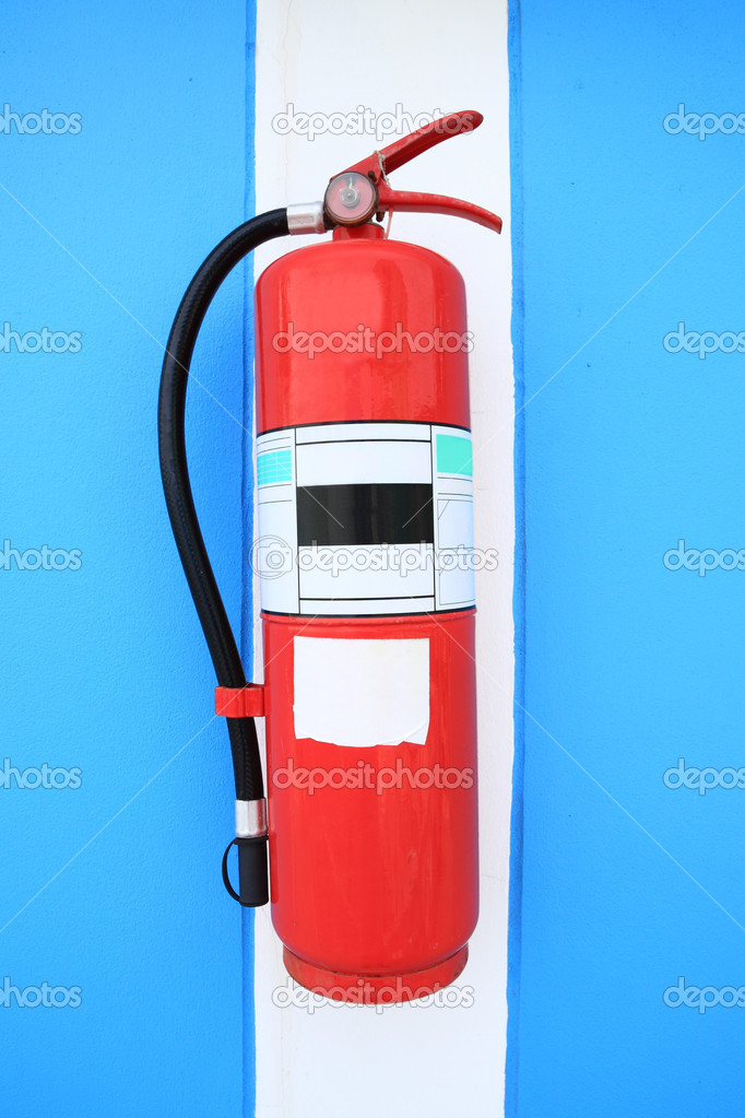 Old fire extinguisher tank on the home wall. — Stock Photo #5262662