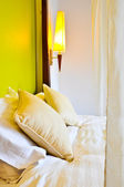 Two pillows on the bed with lamp — Stock Photo