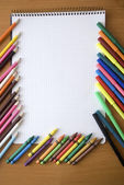 Pencils and notebooks — Stock Photo