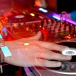 DJ's hands - Stock Photo