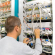 Stock Photo: Network engineer solve the communication problem