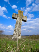 Exalted religious stone cross, cemetery, heaven — Stock Photo