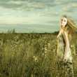 Stock Photo: Beautiful girl in field