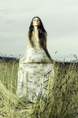 Young woman in the meadow — Stock Photo