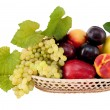 Ripe, juicy apples, grapes, nectarines plums in a wicker basket — Stock Photo #3962361