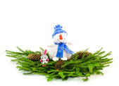 Christmas tree branches with snowman and rabbit — Stock Photo