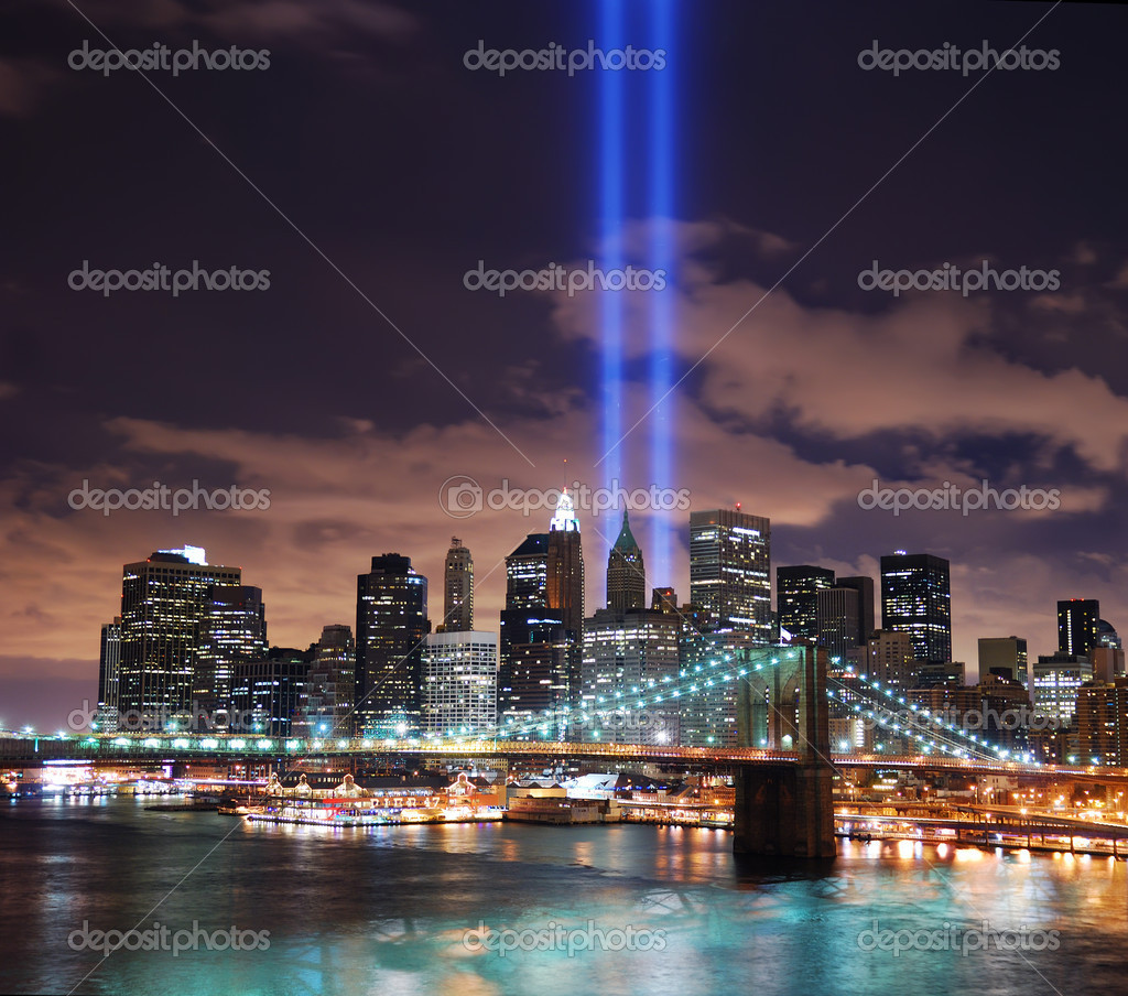 Remember September 11. New York City Manhattan panorama view with Brooklyn Bridge at night with office building skyscrapers skyline illuminated over Hudson Rive — Stock Photo #4001099