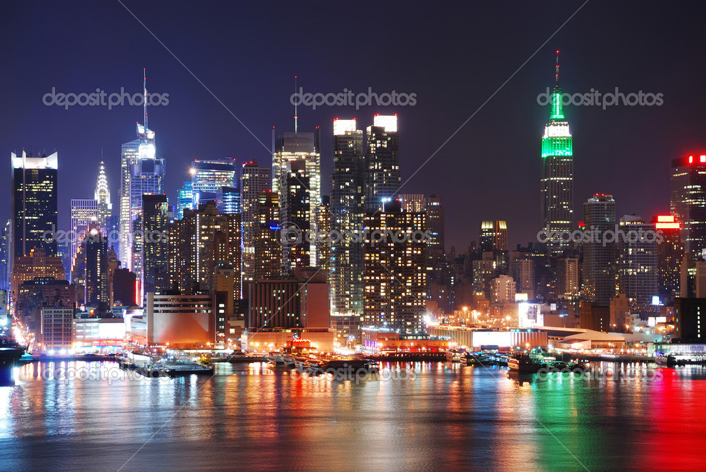 Empire State Building in New York City with Manhattan Skyline at night panorama over Hudson River with reflection. — Photo #4001201