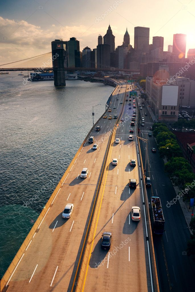 Busy traffic in New York City Manhattan with Brooklyn Bridge across Hudson River at sunset. — Stock Photo #4001648