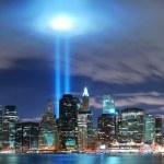 New York City Manhattan skyline illuminated over Hudson River — Stock Photo